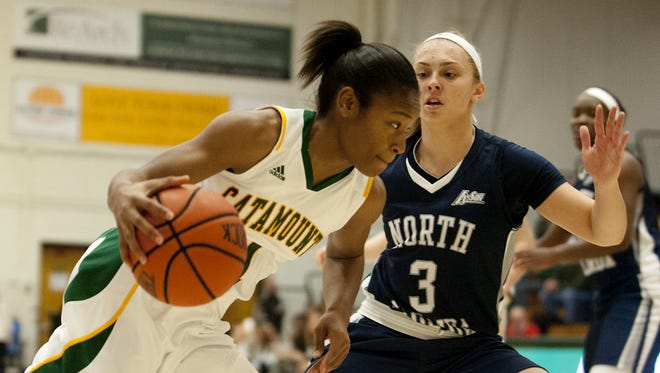 Catamounts guard Kylie Butler (1) drives to the hoop past North Florida guard Bailey Florin (3) during a women's basketball game last season