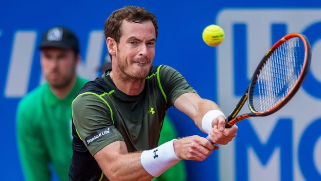 Andy Murray returns to Mischa Zverev during their second-round match of the  BMW Open.