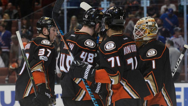Ducks goalie Jonathan Bernier, right, and his teammates celebrate their 6-3 victory against the Rangers at Honda Center in Anaheim.