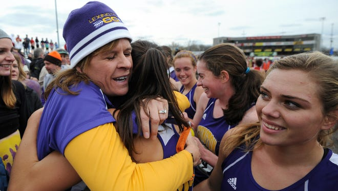 """Lexington head coach Denise Benson is the only coach to pull off a """"double-double"""" winning both the boys and girls team cross country state titles twice."""