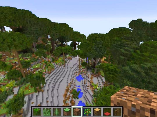 A Minecraft world of Bernheim Arboretum and Research Forest is being created by Minecraft artist and programmer Adam Clarke with partner and poet Victoria Bennett while being artists-in-residence at the Clermont, Ky. nature preserve.