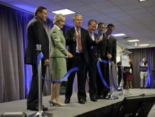 Photo courtesy of Allergan from the ribbon cutting at its new Bridgewater facility in 2012.