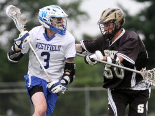 Westfield's Chris Aslanian tangles with Southern Regional's Mike Adragna (on the right) during the NJSIAA Group IV championship lacrosse game, Wednesday, May 28, 2014, at Somerville High School in Somerville, NJ. APP Staff Photo by Jason Towlen