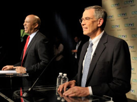 Rep. Rush Holt (right) and then-Newark Mayor Cory Booker share a laugh at the U.S. Senate Democratic primary debate at Montclair State University on Aug. 5, 2013. (NJTV/Joe Sinnott)