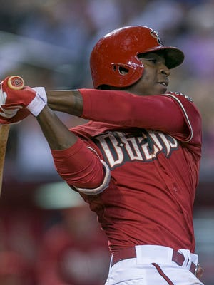 Diamondbacks shortstop Didi Gregorius swings against the Rockies at Chase Field on Saturday, Aug. 9, 2014.