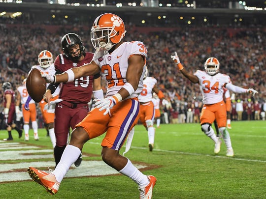 Clemson defensive back Ryan Carter (31) return a interception for a touchdown against South Carolina during the 1st quarter on Saturday, November 25, 2017 at Carolina's Williams Brice Stadium.