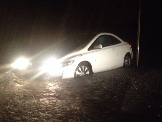 Floodwaters rendered roads impassable around the area tonight.