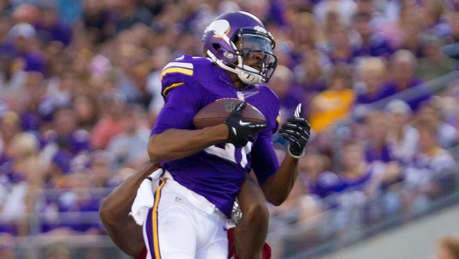 Aug 16, 2014; Minneapolis, MN, USA; Minnesota Vikings wide receiver Jerome Simpson (81) catches a pass in the first quarter against the Arizona Cardinals at TCF Bank Stadium.