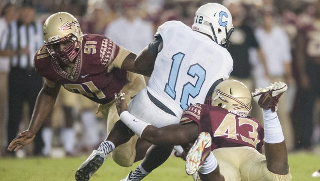 Senior Desmond Hollin (43) is one of the defensive tackles that is impressing his Florida State teammates in the absence of starters Eddie Goldman and Nile Lawrence-Stample, as well as reserve Justin Shanks.