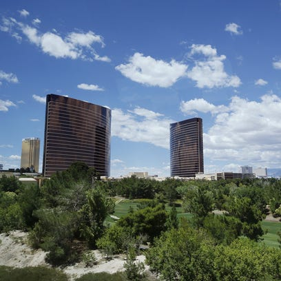 Wynn and Encore hotel towers rise above the Wynn golf course in Las Vegas. The proposed Paradise Park development would put an 38-acre man-made lake on the grounds.