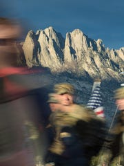 The Organ Mountains serve as a backdrop Sunday March 25, 2018, as participants of the 29th Bataan Memorial Death March pass by at White Sands Missile Range.