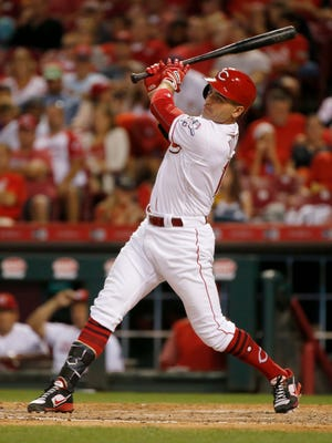 Cincinnati Reds first baseman Joey Votto (19) continues a 13-game hitting streak with a single to center field in the bottom of the sixth inning of the MLB National League game between the Cincinnati Reds and the San Diego Padres at Great American Ball Park in downtown Cincinnati on Tuesday, Aug. 8, 2017. The Reds fell 7-3 in game two of the four game series.