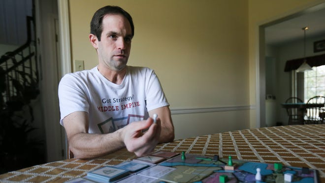 Nate White is the creator of the board game Middle Empire. White, a University of Delaware alumnus, spent three years developing the game, which was released last year.