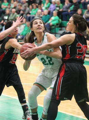 Wall High School's Sam Rocha (22) had a game-high 16 points in a 56-35 District 4-3A girls basketball win against Ballinger at the Wall gym on Tuesday, Jan. 30, 2018. Kenzey Sanchez (12) and Kinlee Bowman defend on the play for Ballinger.