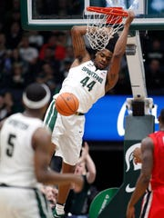 Michigan State's Nick Ward dunks in the first half of an exhibition against Georgia, Sunday, Oct. 29, 2017 in Grand Rapids.