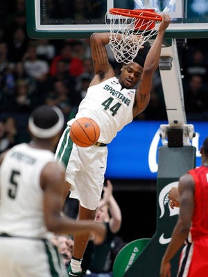 Michigan State's Nick Ward dunks in the first half of the 80-68 exhibition win over Georgia on Sunday in Grand Rapids.