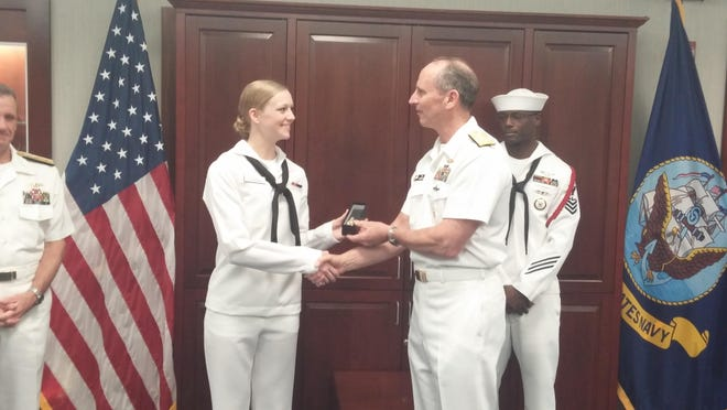 Air Traffic Controller (AC) Brittni R. Latterell is presented with the Military Excellence Award by the Chief of Naval Operations (CNO) Adm. Jonathan Greenert.
