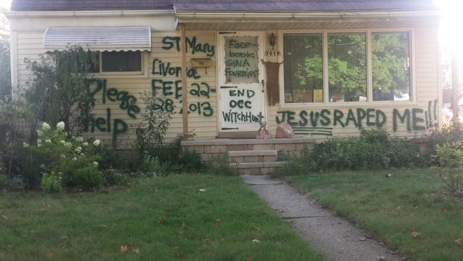 Messages are scrawled across the front of the home at 7016 Deering, apparently written by the homeowner.