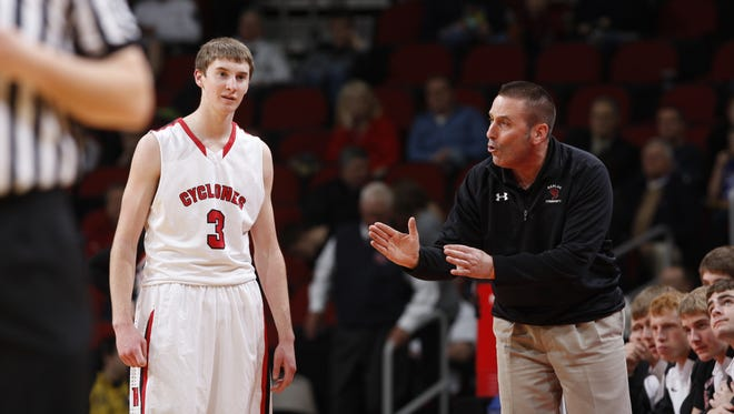 Harlan boys' basketball coach and activities director Mitch Osborn, right, has been diagnosed with lymphoma.