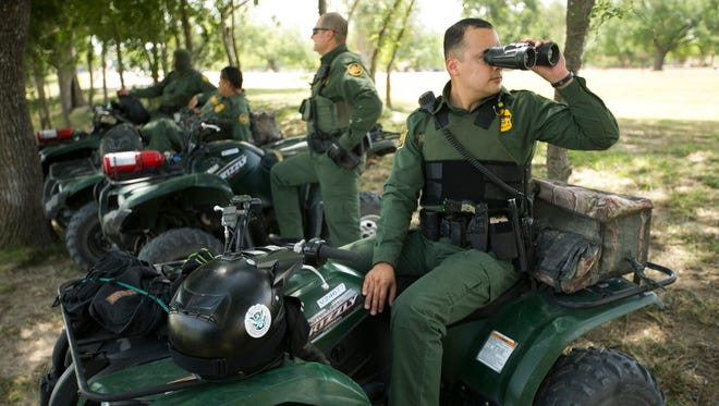 Border Patrol agents keep an eye on activity along the banks of the Rio Grande river in Anzalduas County Park in Mission, Tex., on Saturday, June 21, 2014. The park is a known place for human and drug smuggling from Mexico into Texas.