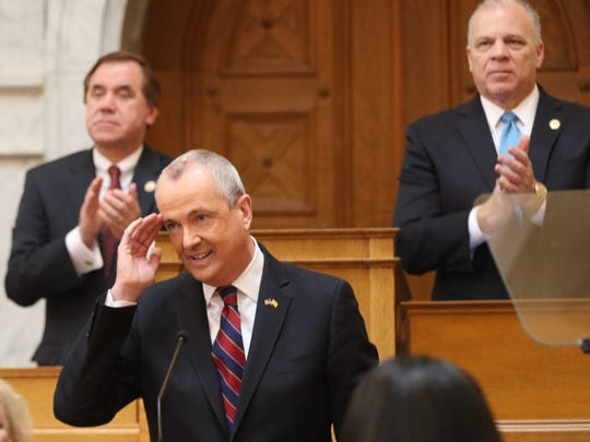 Assembly Speaker Craig Coughlin and Senate President Stephen Sweeney applaud Governor Phil Murphy at the conclusion of his budget address in the Assembly chambers.