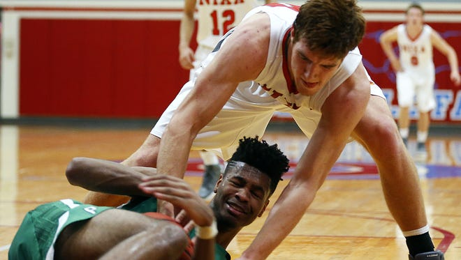 Van Buren High School forward Mitchell Smith (bottom) and Nixa Eagles defender Chase Allen (top) fight for the ball during third quarter action of the Pointers' game against Nixa High School at Glendale High School in Springfield, Mo. on Dec. 11, 2015. Nixa won the game 53-34.