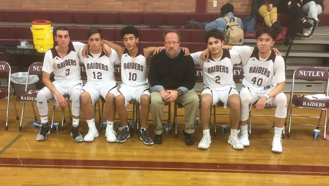 Nutley boys basketball seniors: (from left) Anthony Fabiano, Jon McAloon, Andrew Olivo, coach Bob Harbison, Matt Schettino and Elmer Zamora.