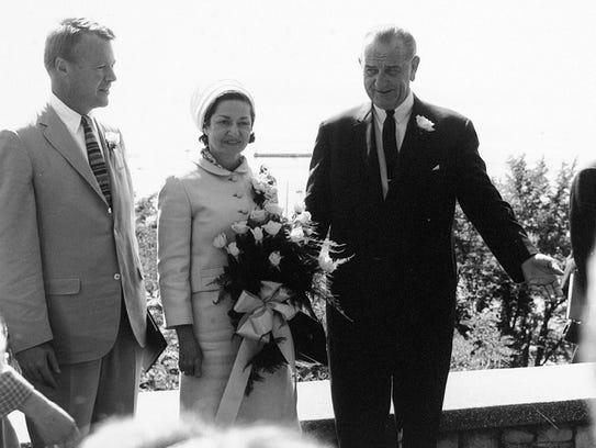 Gov. Phil Hoff greets President Lyndon B. Johnson and