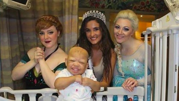 Maggie McAndrew and Kylee McGrane with Miss New York Serena Bucaj and a child at the Children's Hospital at Montefiore in Bronx, NY.