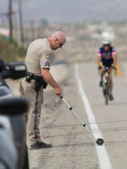 A California Highway Patrol officer investigates the