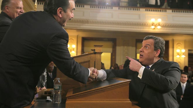"""NJ Assembly Speaker Vincent Prieto (left) is playing a game of """"chicken'' over the fate of financially strapped Atlantic City, says Gov. Chris Christie. Here, Prieto is greeted by Christie in the Assembly Chamber at the Statehouse in Trenton Tuesday, February 16, 2016, before Christie's annual Budget Address. Photo by Thomas P. Costello / Asbury Park (NJ) Press"""