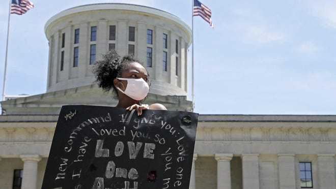 Lamiqua Nowell of Columbus demonstrates with the Xenos Church at the Ohio Statehouse in Columbus on Sunday, June 7, 2020.