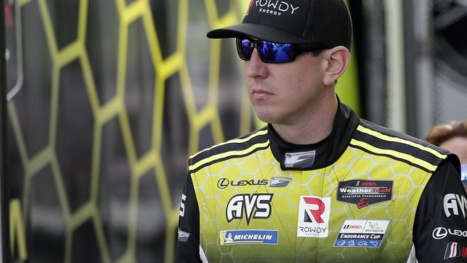 In this Friday, Jan. 3, 2020, file photo, Kyle Busch heads to his garage during testing for the upcoming Rolex 24 hour auto race at Daytona International Speedway in Daytona Beach, Fla.