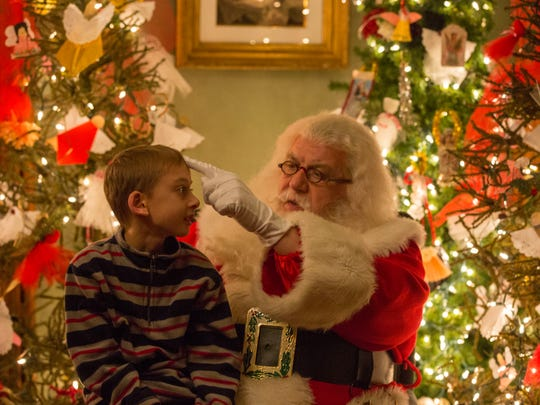 Grant Orman, 10, tells Santa that he wants Lego trains