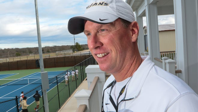 Coach Joey Eskridge watches over the men's and women's teams during practice at the Anderson University Sports Complex tennis courts.