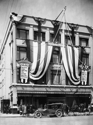 The Pettibone-Peabody Co. building was decorated for Appleton's Homecoming celebration for returning World War I soldiers and sailors in May 1919. The building was on College Avenue.