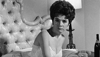 """In this July 18, 1963, file photo, actress Polly Bergen works on a scene during the filming of ?Move Over, Darling,? in the Hollywood section of Los Angeles. Bergen, an  Emmy-winning actress and singer, who in a long career played the terrorized wife in the original """"Cape Fear"""" and the first woman president in """"Kisses for My President,"""" died Saturday, Sept. 20, 2014, at her home in Southbury, Conn., publicist Judy Katz said. She was 84."""