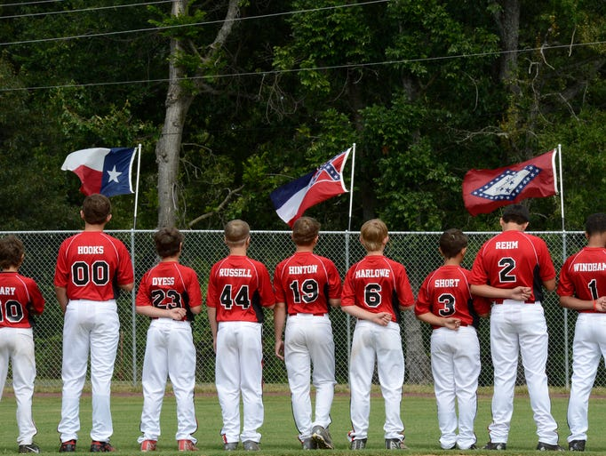 Members of the the Petal Mississippi All Stars listen to the National Anthem during opening ceremonies.