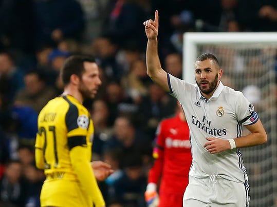 Real Madrid's Karim Benzema, right, celebrates after scoring a goal during the Champions League, Group F, soccer match between Real Madrid and Borussia Dortmund at the Santiago Bernabeu stadium in Madrid, Spain, Wednesday, Dec. 7, 2016. (AP Photo/Daniel Ochoa de Olza)