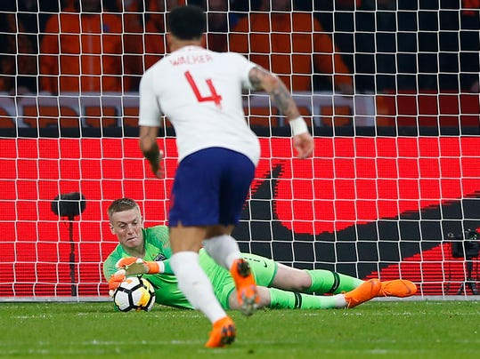 England's goalkeeper Jordan Pickford makes a save during the international friendly soccer match between the Netherlands and England at the Amsterdam ArenA in Amsterdam, Netherlands, Friday, March 23, 2018. (AP Photo/Peter Dejong)
