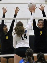 Alamogordo's Paige Herrell, left, and Alex Veyna try
