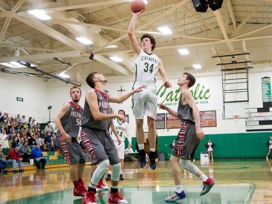 Catholic's Brock Jancek (34) goes for a layup during a Region 2-AA boys tournament game between Knoxville Catholic and Union County at Catholic High School in Knoxville, Tennessee on Saturday, February 25, 2017.
