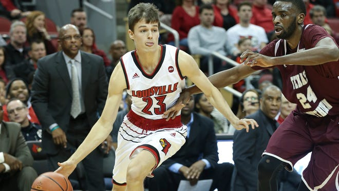 U of L's David Levitch (23) drives against Texas Southern's Marvin Jones (24) during their game at the KFC Yum! Center.Dec. 10, 2016