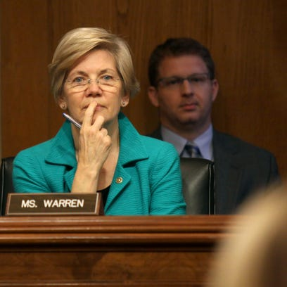 Sen. Elizabeth Warren, D-Mass. listens on Capitol Hill in Washington, Wednesday during the Senate Aging Committee hearing to examine older Americans and student loan debt.
