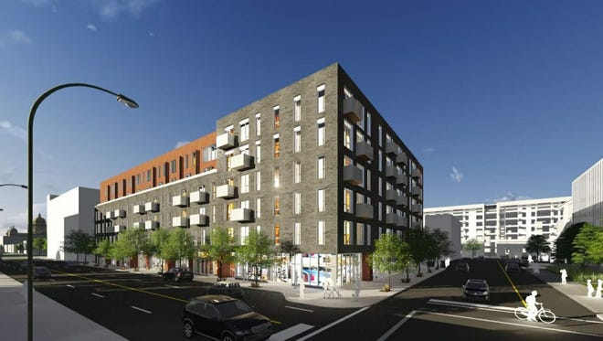 A proposed apartment complex in Des Moines' East Village is one of several projects in the area using weathered steel, a building material that builds up a visible coat of rust.