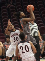 Mansfield Senior's Manny Bronson makes a jump shot
