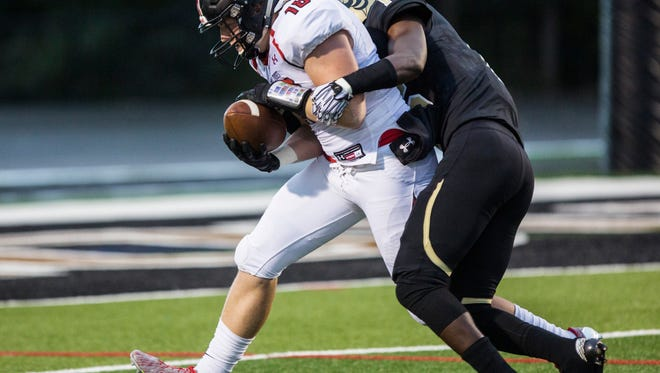 T.L. Hanna's Tyrese Ford (16) tackles Boiling Springs' Michael Bollinger. On Saturday, Ford announced a commitment to North Greenville.