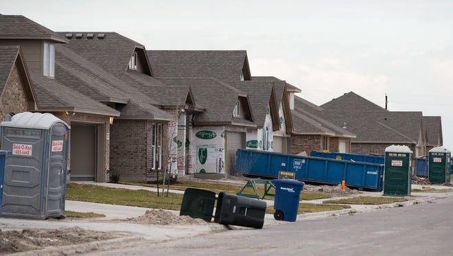 COURTNEY SACCO/CALLER-TIMES A line of new homes being built in the Rancho Vista subdivision, Friday, Feb. 5, 2016.