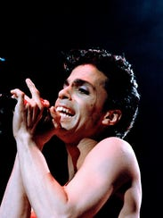 Rock singer Prince sings to a full house on the first
