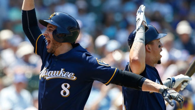 Brewers Ryan Braun (left) and Hernan Perez celebrate after a Braun homer against the Cubs earlier this season.